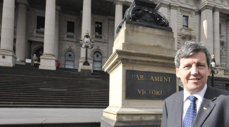 Robert Clark in front of Victorian Parliament building